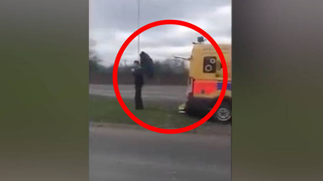 Man blocks speed camera with umberlla