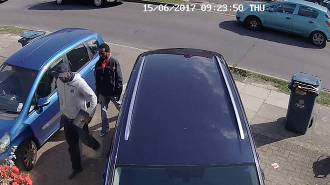 CCTV image of two men approaching the house.