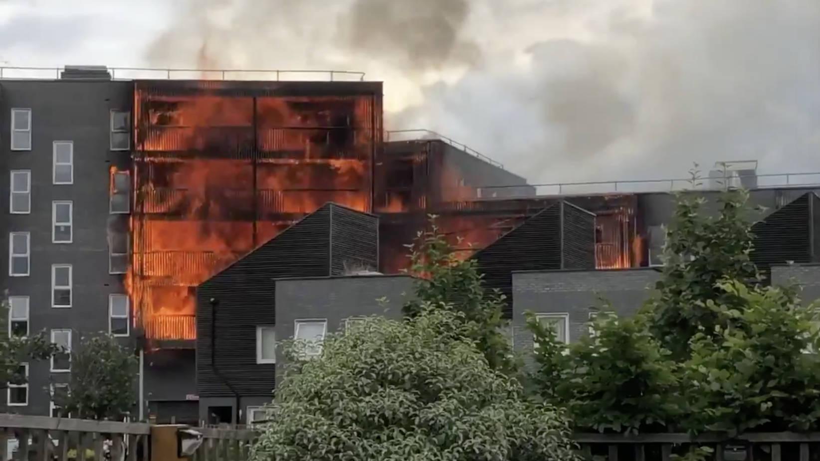 100 Firefighters Battle Blaze At Block Of Flats In East London
