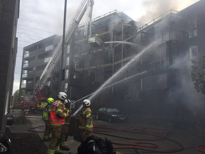 Firefighters tackle the six-story flat fire in Barking