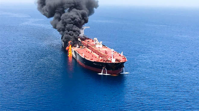 Fire and smoke seen billowing from an oil tanker believed to have been attacked in the water of the Gulf of Oman.