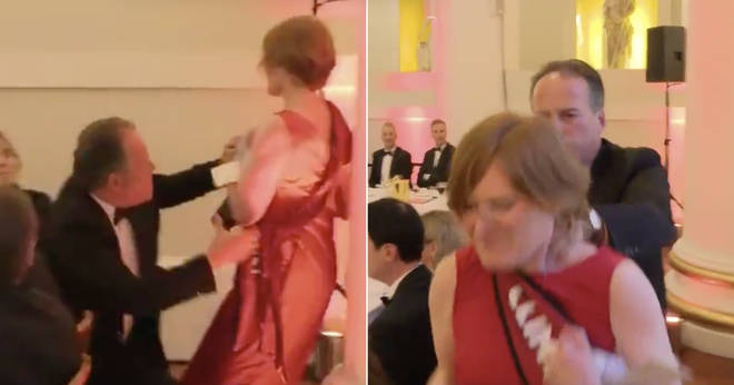 The moment MP Mark Field physically removes a Greenpeace protester
