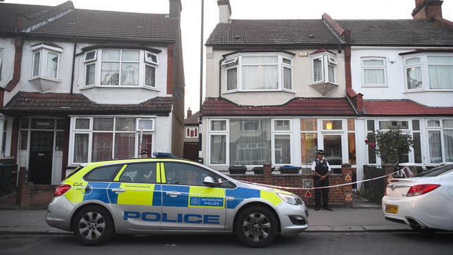 Police outside a property in Raymead Avenue, Croydon