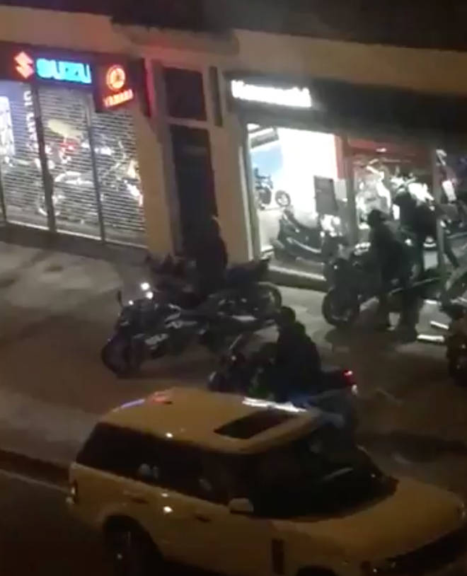 The gang were filmed raiding the motorcycle shop in Windmill Hill, Ruislip.