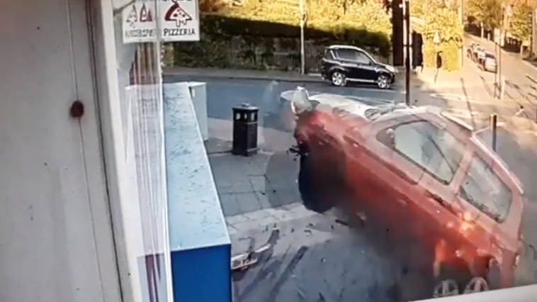 "Watch ""Manic Motorist"" Smashes Car Through Takeaway Window"