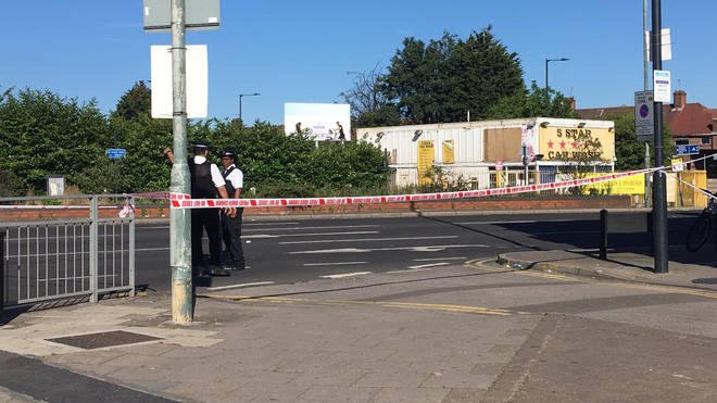 A police cordon remains in place after a man died following a shooting in Wembley