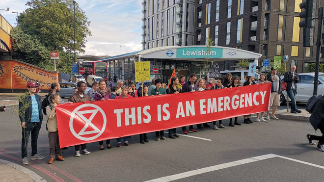 Extinction Rebellion protesters block a road in south-east London