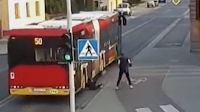 Girl almost pushed under the wheels of a bus by her friend