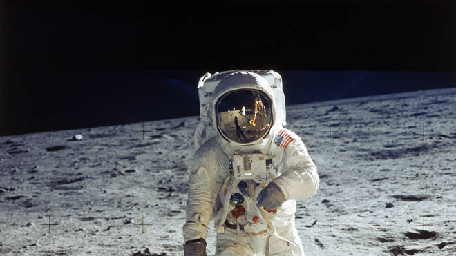 Apollo 11 astronaut Buzz Aldrin standing on moon