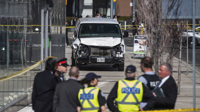A police cordon around a damaged van in Toronto.