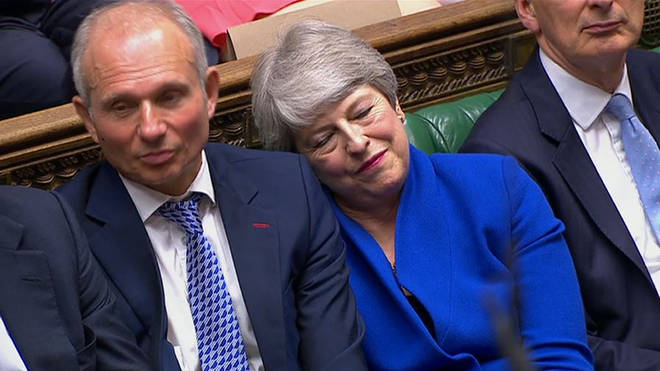 Prime Minister Theresa May leans on the Minister for the Cabinet Office David Lidington during her last Prime Minister's Questions in the House of Commons, London.