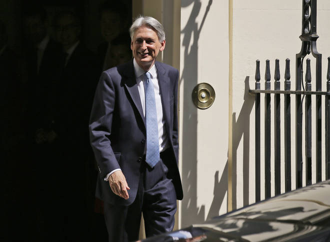 Philip Hammond leaves Downing Street on Wednesday