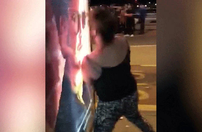 Woman headbutts bus stop