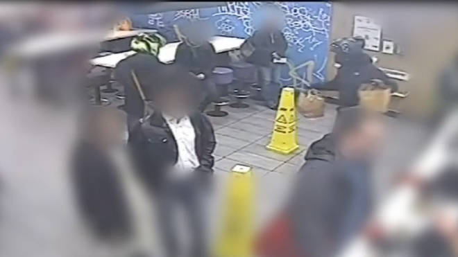 The men were seen using a stolen card to buy food at a McDonalds.