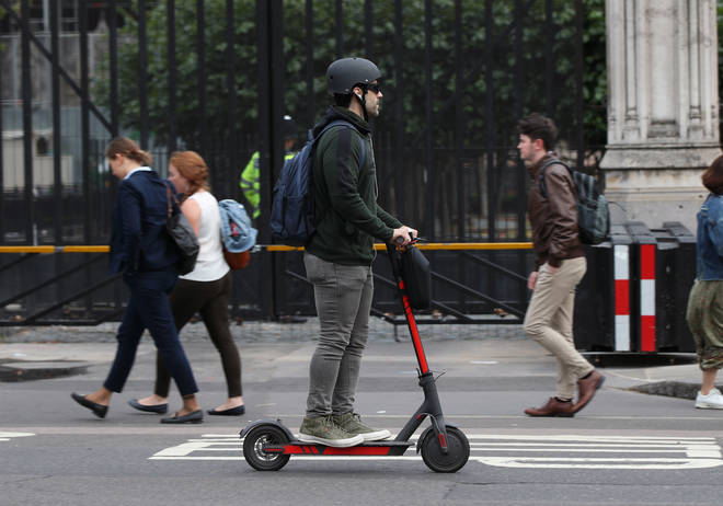 A person rides an electric scooter in Westminster