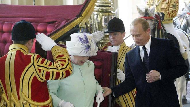 Vladimir Putin meets the Queen