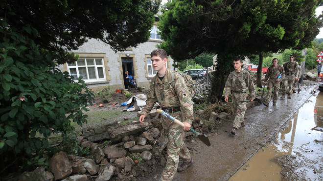 Soldiers from 2 Yorks arrive in Grinton, North Yorkshire to help out with flood damage, after parts of the region had up to 82.2mm of rain in 24 hours on Tuesday.