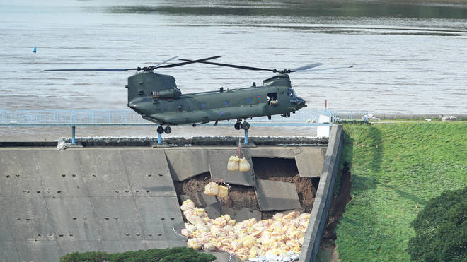 AN RAF Chinook drops stones in an attempt to save the town.