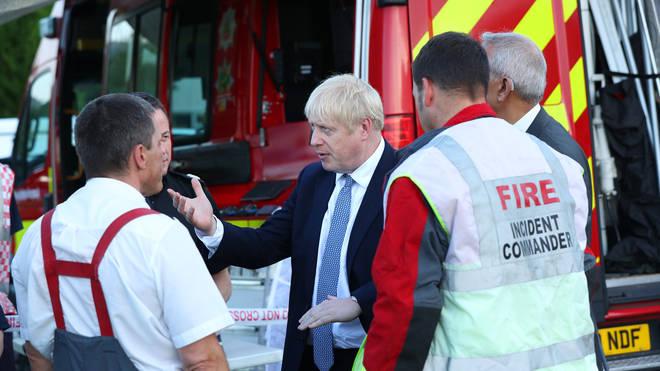 Prime Minister Boris Johnson spoke to emergency services at Whaley Bridge