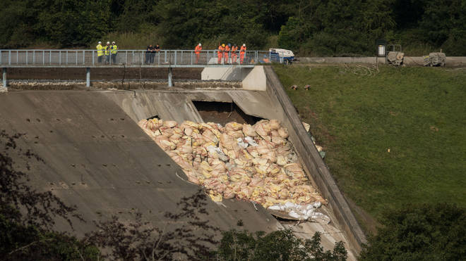 Engineers and emergency services have been trying to prevent the dam from collapsing