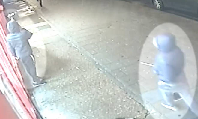 Baptiste is pictured on CCTV holding a large knife in the moments before the attack