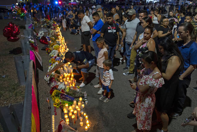 People gather at makeshift memorial for the victims of Saturday's mass shooting at a shopping complex in El Paso, Texas, Sunday, Aug. 4. Picture: PA