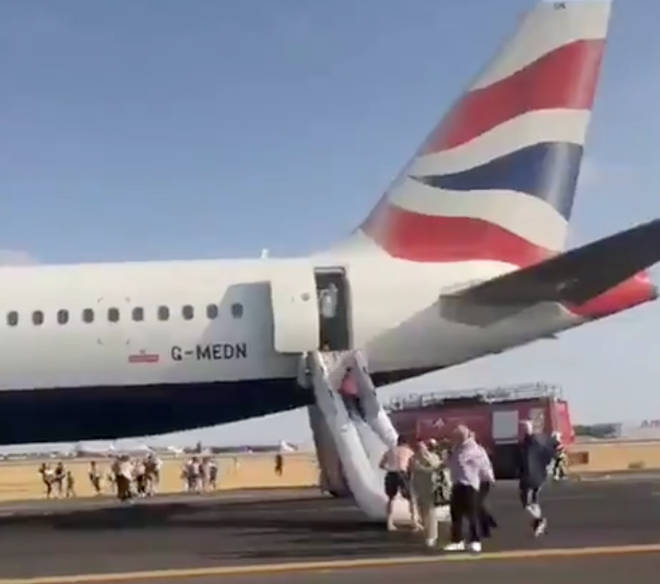 The BA flight as passengers are evacuated
