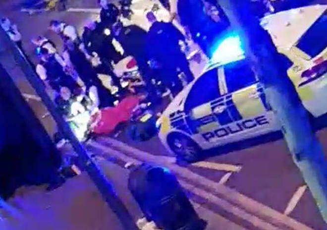 The police officer receives attention following the incident in Leyton