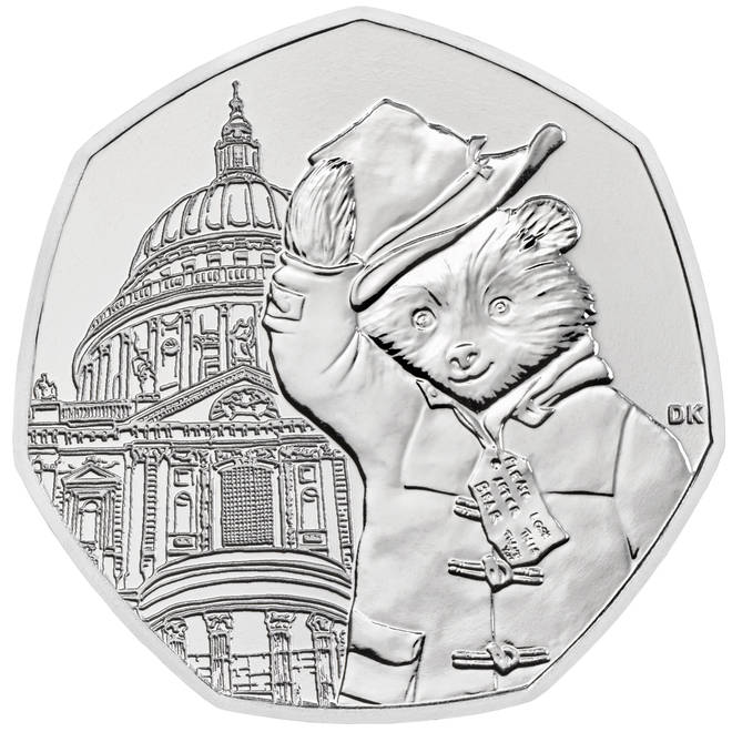 One coin has the bear lifting his hat outside St Paul's Cathedral