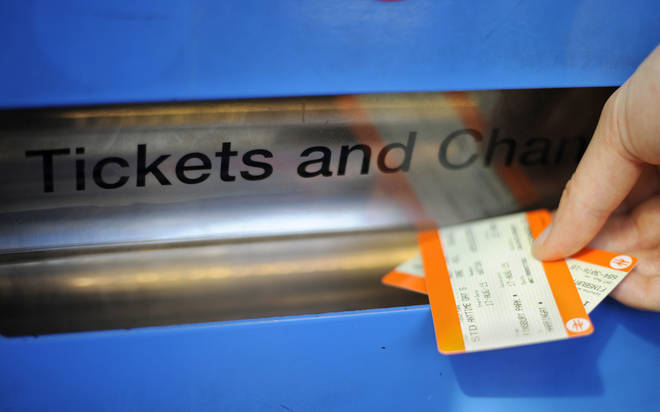 A passenger buying train ticket at Finsbury Park station, London.