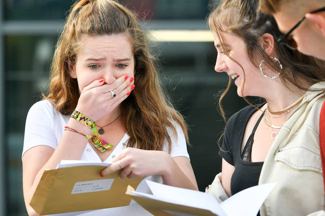 A Sixth Former reacts as she opens her A Level results