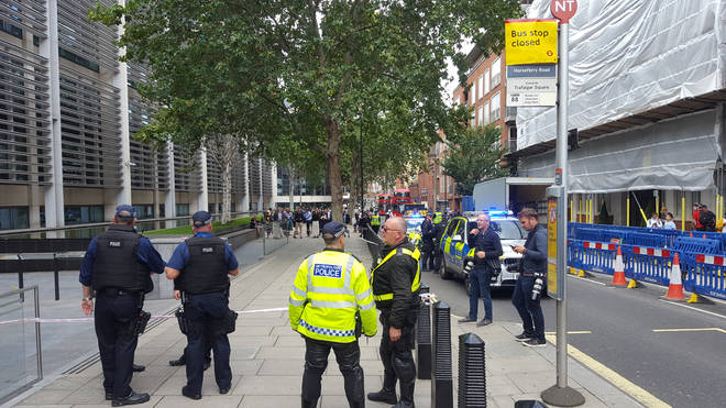 Armed Police cordon off the scene outside the Home Office