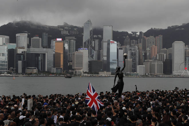 As protests in Hong Kong continue, police have received a report about a British foreign ministry employee who has been missing since crossing into China on a business trip report