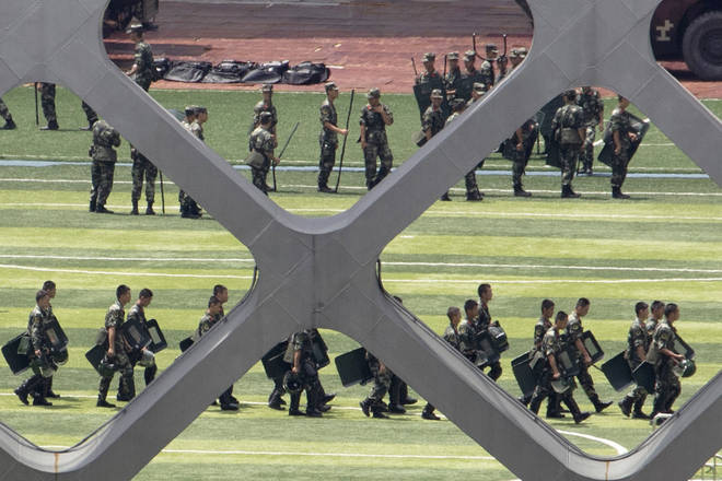 Chinese paramilitary policemen go through drills at the Shenzhen Bay Stadium in Shenzhen in Southern China's Guangdong province, Sunday, Aug. 18, 2019.