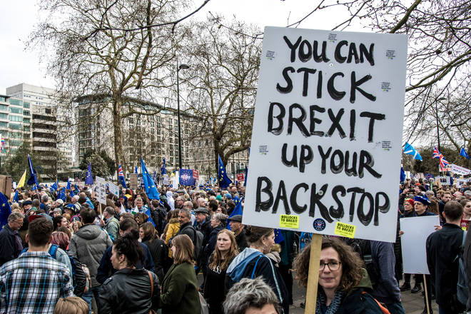 A protester seen holding a placard that says you can stick Brexit up your backstop during the People's Vote demonstration.