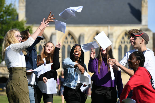 Pupils celebrate their GCSE results at Norwich School in Norfolk.
