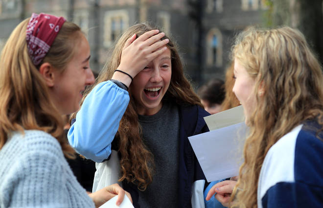 Students at Brighton College in Brighton celebrate after collecting their GCSE results.