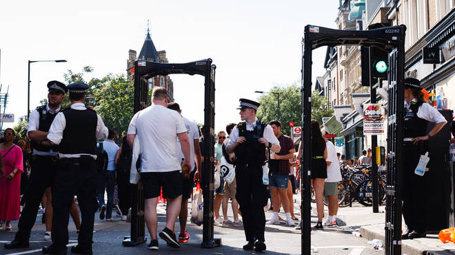 Police with screening arches at the Notting Hill Carnival