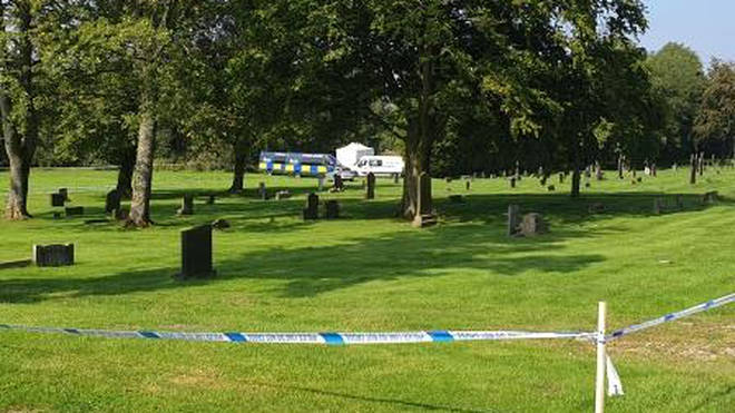 A teenage boy has been arrested on suspicion of murder after a teaching assistant was found dead in a cemetery