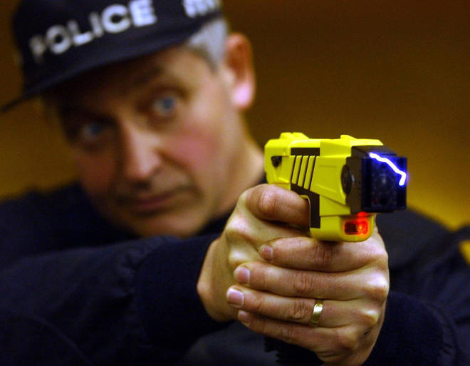 A US police officer discharges a taser