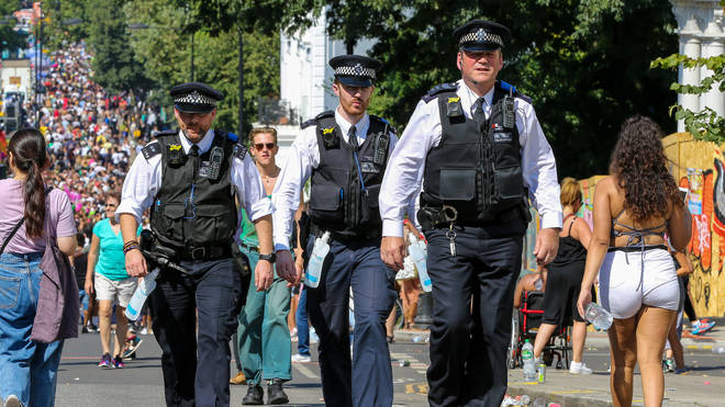 Police officers at this year's Notting Hill Carnival, where a woman had part of her lip bitten off
