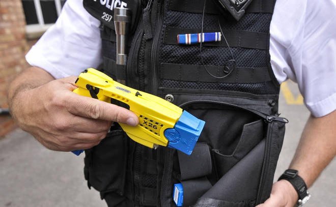 A police officer shows off a taser