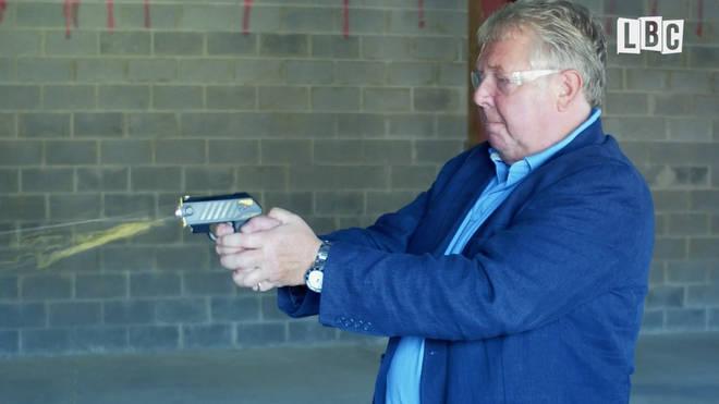 Nick Ferrari firing a taser
