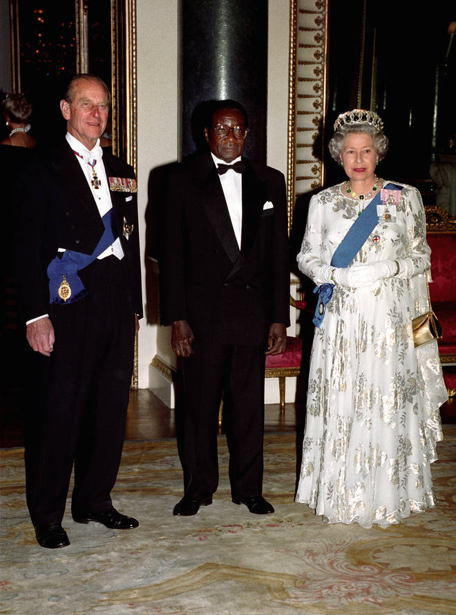 """He was an outspoken critic of the UK, calling it an """"enemy country"""". He is pictured here with Queen Elizabeth and Prince Philip"""