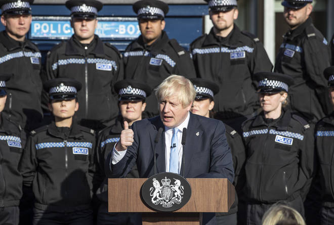 Prime Minister Boris Johnson used police officers as a backdrop for a political speech