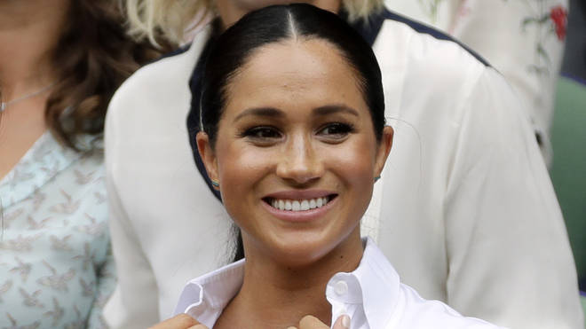 Meghan Markle, pictured here at Wimbledon, has flown out on a commercial plane to watch the US Open