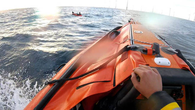 A man was rescued after the toy dinghy he was in was blown a mile out to sea.