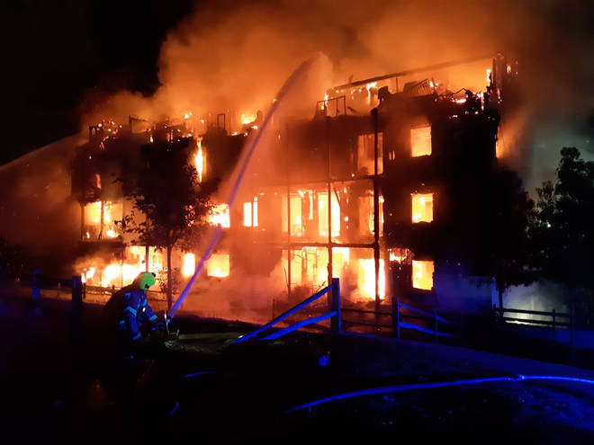 Firefighters tackle the blaze at the block of flats