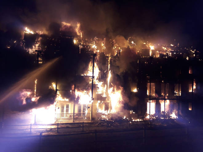 The fire engulfed all four floors of the building.