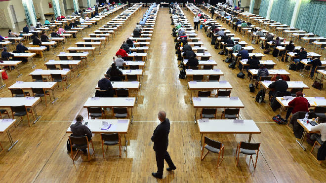 A report has suggested all watches should be banned from exam halls in order to battle cheating